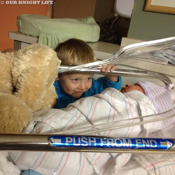 Boy meets brother for first time